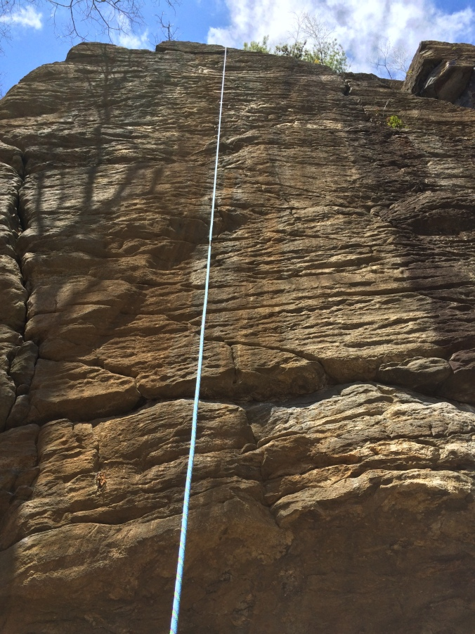 My jugged a line that fell to the left of that 5.11 crack on a less featured section of the face.