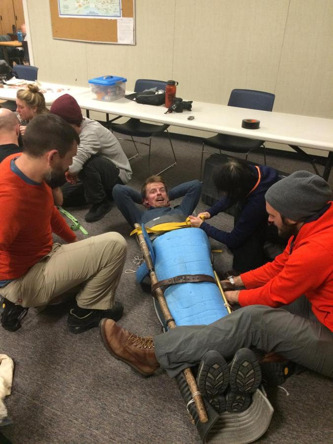 Making a body splint for a full pelvic and leg fracture out of sticks, foam and paracord. I am the one in dark blue. Oh, I didn't bring a brush with me so I ended up looking like a Gremlin towards the end of the course.