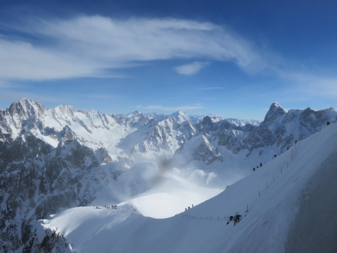 Skiers making their way down the Aig. du Midi ridge